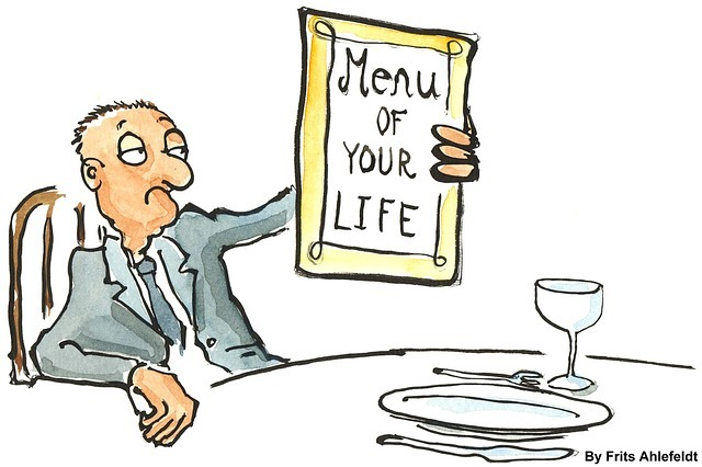 """Elderly man with """"menu of your life"""" in front of him at restaurant. End-of-life decision making is The menu to discuss at a Palliative Care meeting with the medical team."""