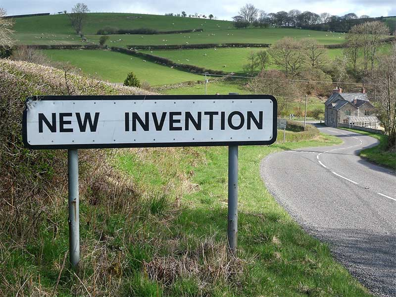 """Road sign pointing out """"New Invention"""" - which is needed in dysphagia research"""