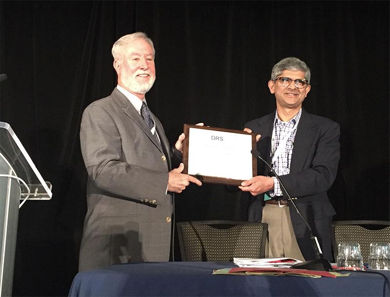 Dr Joel Ritcher receives an award fromSudarshan R. Jadcherla, MD, DCH, FRCP (Irel), AGAF